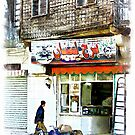 Man and bicycle in front of a shop Aleppo by Giuseppe Cocco