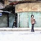 woman and man sitting on a chair in Aleppo road by Giuseppe Cocco