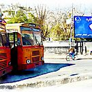 Buses and child riding a bicycle in Aleppo by Giuseppe Cocco