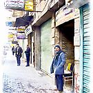 Man out of the shop on a street in Aleppo by Giuseppe Cocco