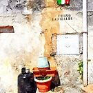 Gas bottle crock and italian flag in street of Tortora by Giuseppe Cocco