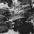 Black and White Shot of Small Bridge in Japanese Garden by visualspectrum