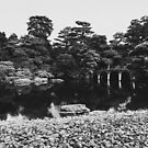 Black and White Shot of Bridge in Large Japanese Garden by visualspectrum