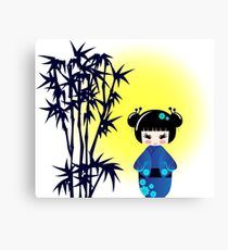 Japanese kokeshi doll at bamboo at sunrise Canvas Print
