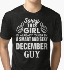 SORRY THIS GIRL IS ALREADY TAKEN BY A SMART AND SEXY DECEMBER GUY Tri-blend T-Shirt