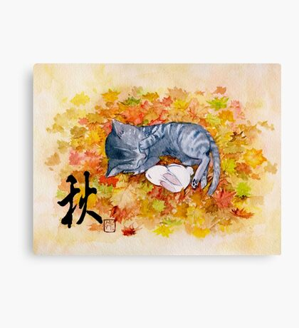 Kitty cat taking a nap with a bunny rabit on autum leaves Canvas Print