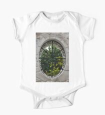 A Lush Garden Framed in a Fence Window One Piece - Short Sleeve