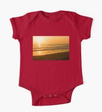Glossy Gold and Surfers - Sunset on the Beach in California  One Piece - Short Sleeve