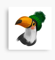 Cute toucan bird in a winter knitted hat Canvas Print