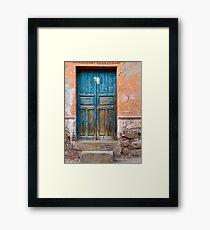 Blue door against Orange Framed Print