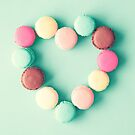 Heart of macarons of macarons over mint blue background by Caroline Mint