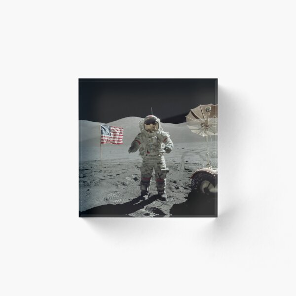 Apollo 17 astronaut stands near the American flag on the lunar surface. Acrylic Block