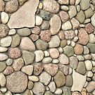 Rocks in the Sand by Graphxpro