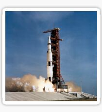 Apollo 11 space vehicle taking off from Kennedy Space Center. Sticker