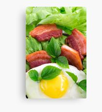 Top view on egg yolk, fried bacon and herbs Canvas Print