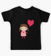 Cute girl with a heart shaped balloon Kids Tee