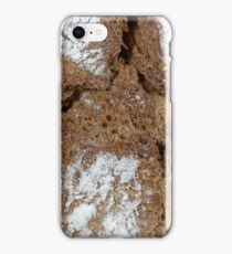 Macro photo of the surface of brown bread from Germany. iPhone Case/Skin