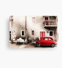 Old vintage italian scene. Small antique red car. Canvas Print