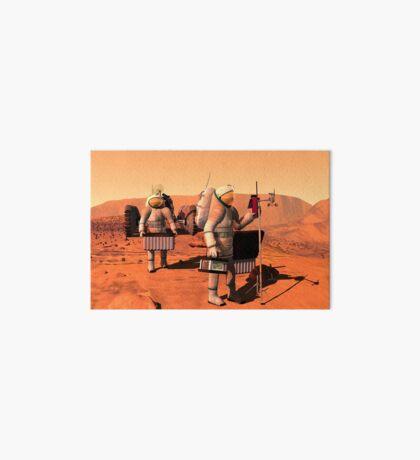 Das Konzept des Künstlers von den Astronauten, die Wetterüberwachungsausrüstung auf Mars errichten. Galeriedruck