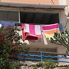 Washing on the balcony. by Anne Scantlebury