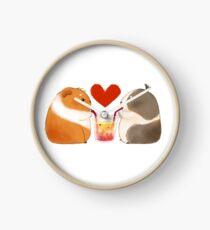 Reloj Conejillos de Indias enamorados