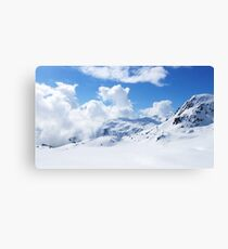 Snowy mountains with clouds Canvas Print