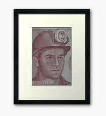 Miner in the helmet with a flashlight Framed Print
