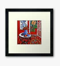 red interior with tropical garden view Framed Print