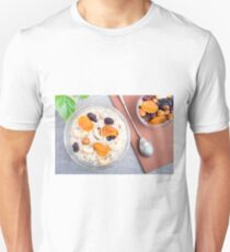Top view of a portion of oatmeal with fruit and berries in a glass T-Shirt