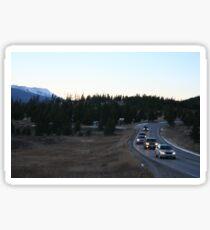 Cars around a bend on a Breckenridge Road  Sticker