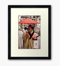 Geisha in the Rain Framed Print