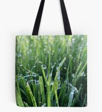 Dew drops on green grass Tote Bag