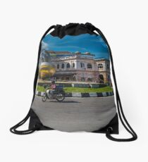 Little bike and a Big Sculpture Drawstring Bag