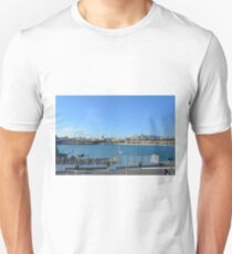 MALAGA, SPAIN, December 28, 2016, People are walking on a promenade surrounded by marina in the port of Malaga in Spain. T-Shirt
