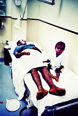 Little boy in hospital bed by Brett Squires