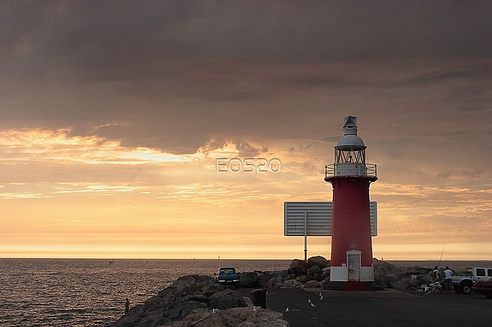 Stormy Sunset  At North Mole Lighthouse  by EOS20