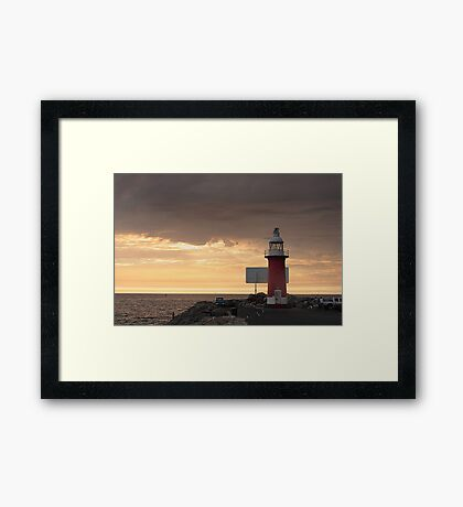Stormy Sunset  At North Mole Lighthouse  Framed Print