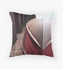 Rowboat ashore the ore dock Throw Pillow