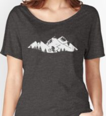 Wheelie in front of mountains Women's Relaxed Fit T-Shirt