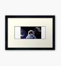 space man watching a battle Framed Print
