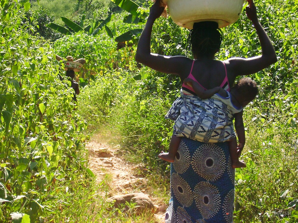 A woman bringing water to her village. by fergal