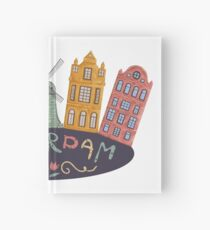 Amsterdam. Old historic buildings and traditional architecture of Netherlands. Windmill and houses with hand drawn lettering. Hardcover Journal
