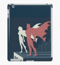 Super heroes atop a skyscraper. Male and female super heroes standing strong together in a cityscape. iPad Case/Skin