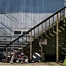 Red Bike near the stairs by mypic