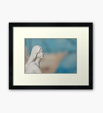 mermaid sitting by the sea Framed Print