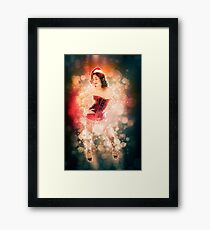 Young sexy woman in a red corset wearing Santa hat  Framed Print