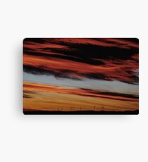 Wind Turbines Farm In The Distance On Beautiful Red, Orange And Blue Sunset Canvas Print