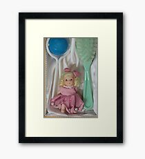 Doll brush rattle close to Framed Print