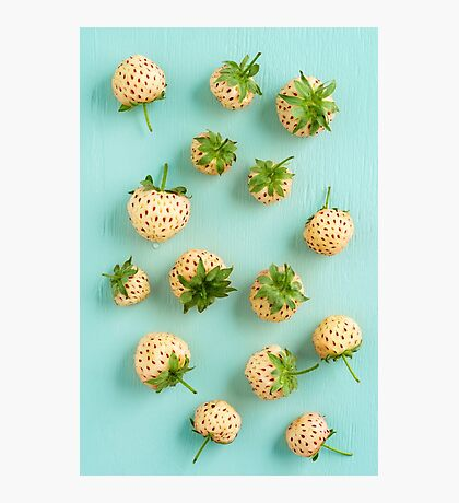 Fresh pineberries on turquoise Photographic Print