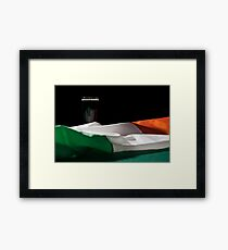 St Patrick day with a pint of black beer and irish flag over a green table Framed Print